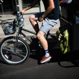 DENVER, CO - JULY 21: Scraps intern Joel Cruz bikes through the streets of Denver, Colorado to collect compost from their clients on July 21, 2017. (Photo by Gabriel Scarlett/The Denver Post)