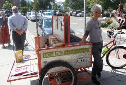 pedal truck for delivering books. Manufactured by Main Street Mobility in Colorado.