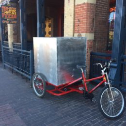 Carry cargo with pedal powered vehicle. Vehicles made by Main Street Mobility