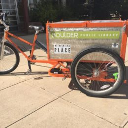 Boulder Public Library goes outside with their new library trike! Vehicle made by Main Street Mobility.